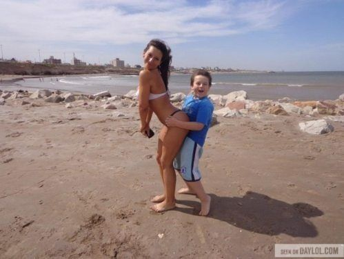 kid on a beach with a hot woman